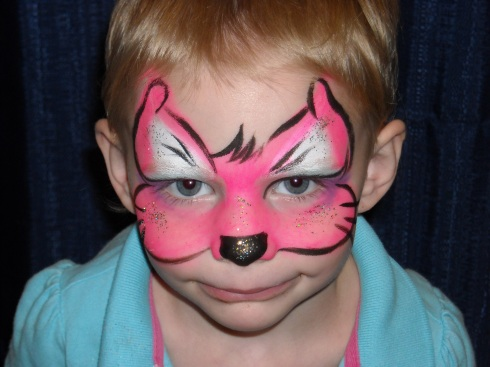 Maddison Blu with face painted as a pink Kitty